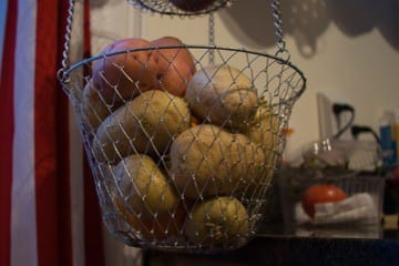This hanging basket holds potatoes, but yours can hold toiletries in your bathroom.