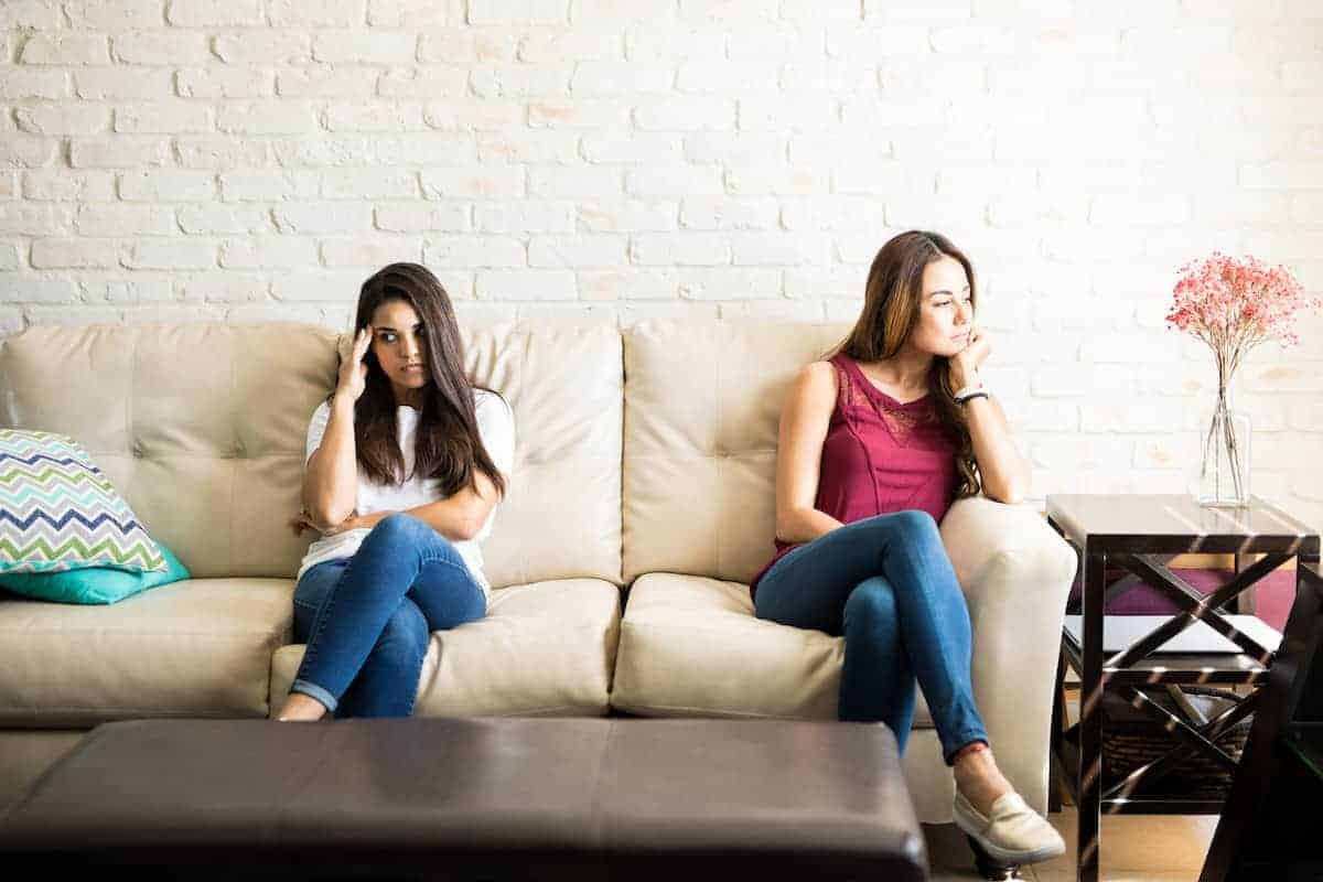 girls sitting on couch after a fight