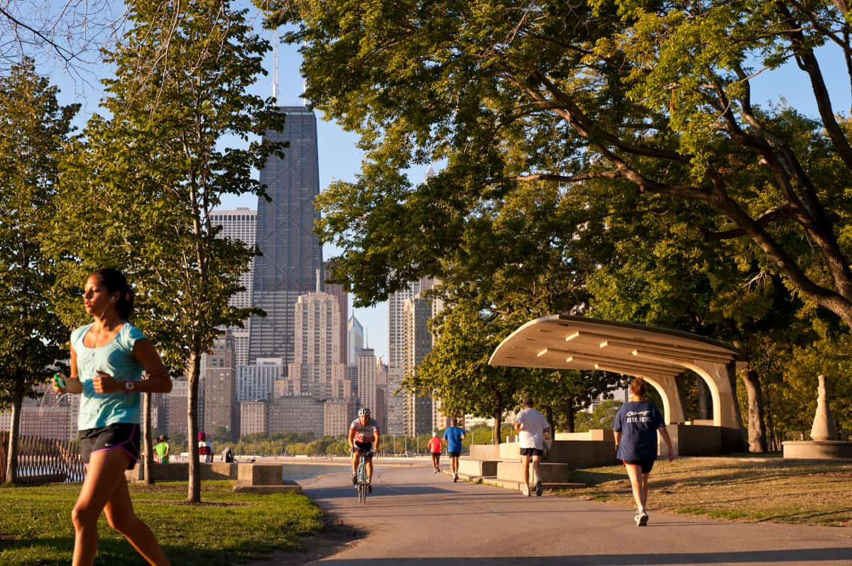 Runners through a park in Chicago, IL