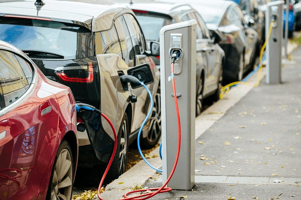 Electric vehicles charging on the street.