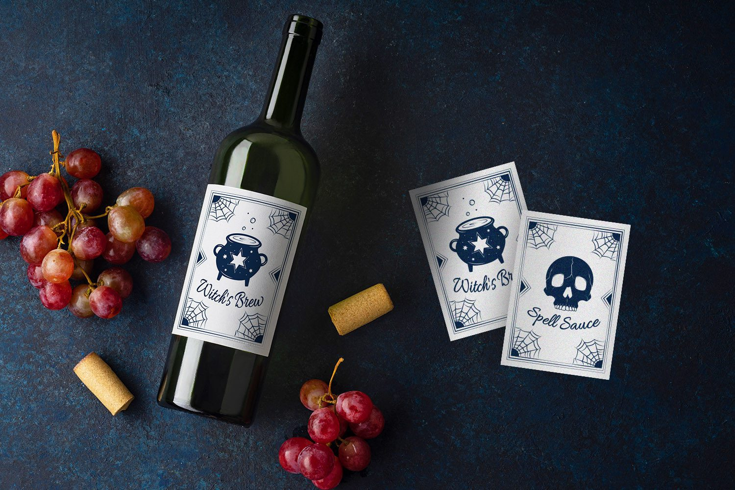 Flatlay with bottle of red wine, corks and red grapes on blue background with copy space
