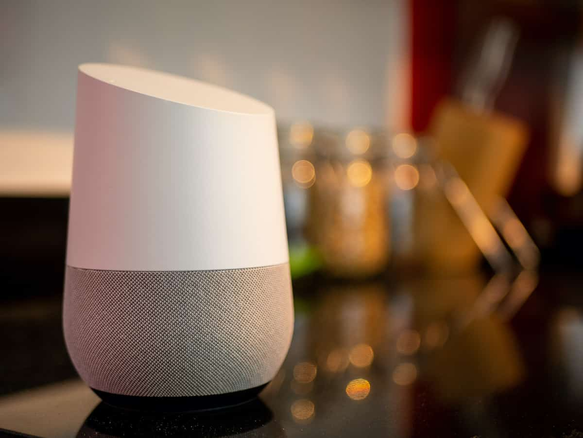 A Home device sitting on a counter. google home hacks