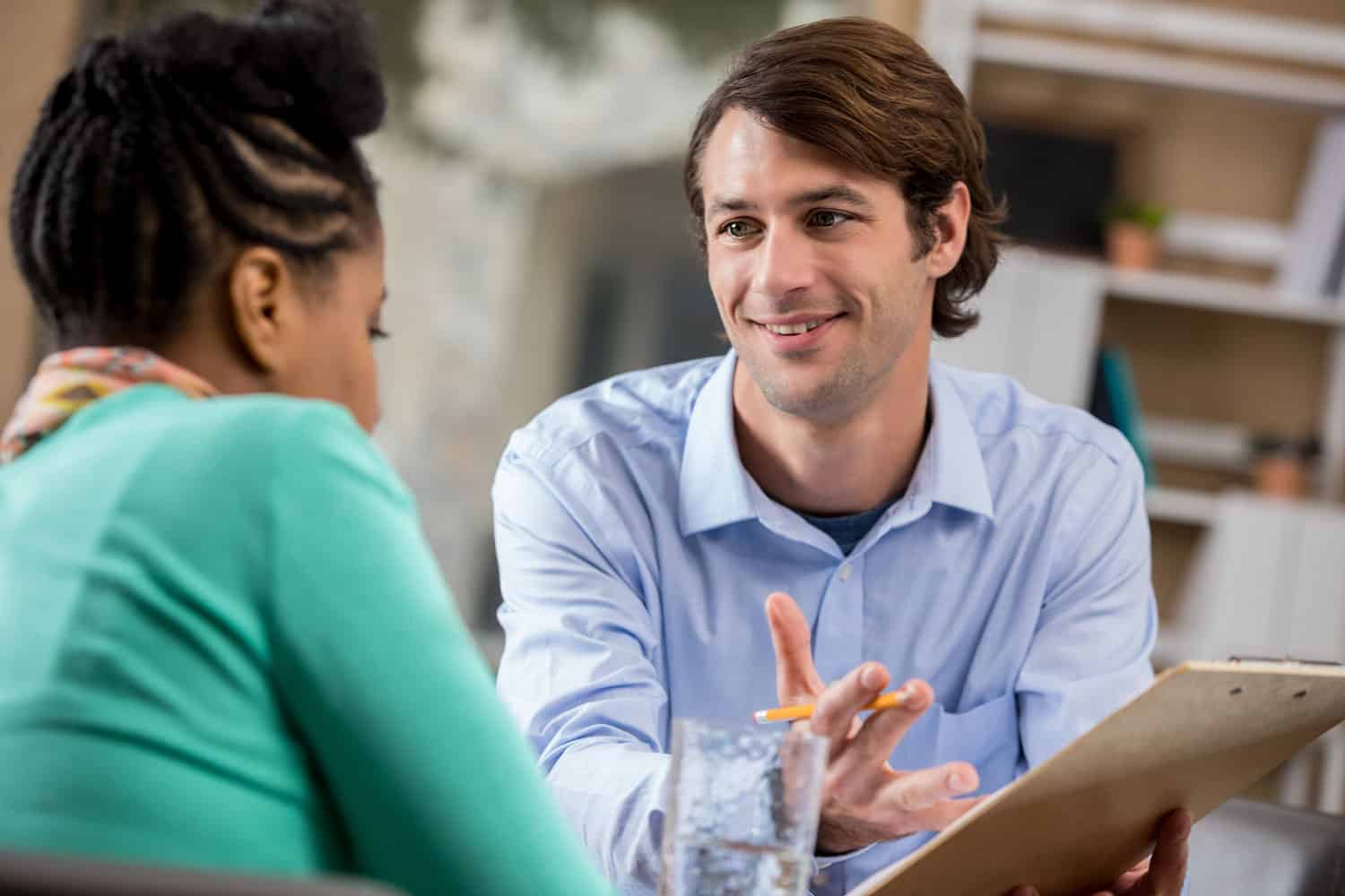 man discussing lease with woman