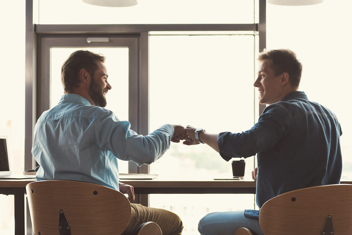 Friends in agreement with a fist bump